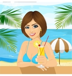 Woman at the beach drinking cocktail vector