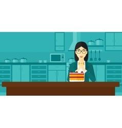 Woman looking at cake vector image