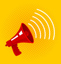 Red megaphone on yellow background vector