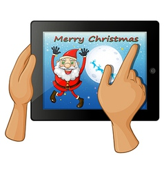 A finger touching a gadget with a smiling Santa vector image
