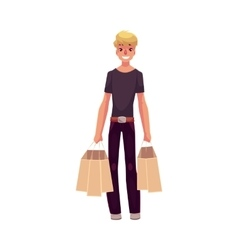 Smiling young man standing with shopping bags vector image vector image
