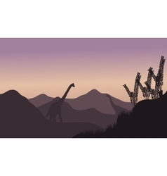 Silhouette of two brachiosaurus in fields vector