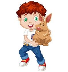Boy hugging a brown rabbit vector image