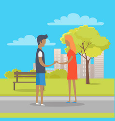 Young boy and girl in love stand on park path vector