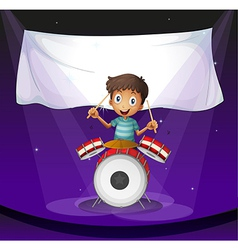 A drummer at the stage with an empty banner at the vector image