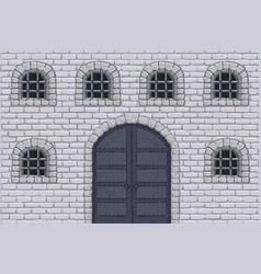 Medieval castle wall with doors and barred windows vector
