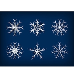 White frozen set of snowflakes on dark blue vector