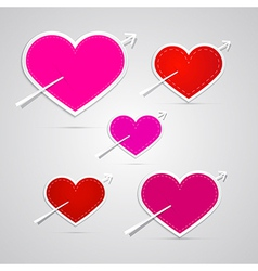 Paper red pink hearts pierced with arrows vector
