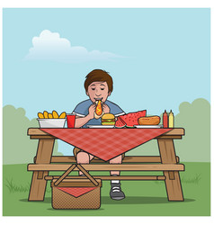 Boy at a picnic table vector