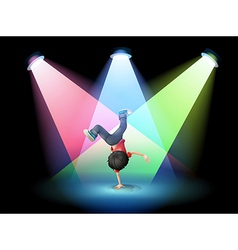 A boy breakdancing at the stage with spotlights vector