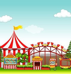 Shops and rides at the amusement park vector