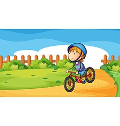 A young boy biking outdoor vector