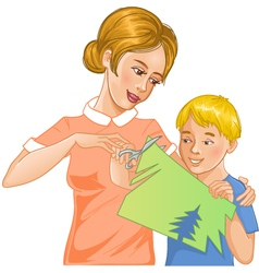 Mother helps son to cut color paper vector image