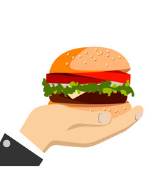 Hand holding a burger vector