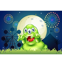 A green monster scaring at the amusement park vector