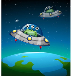 Spaceships with aliens vector