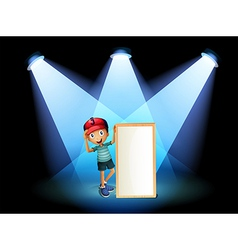 A boy holding an empty frame with spotlights vector image