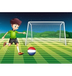 A male player kicking the ball with the flag of vector