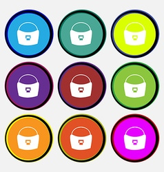 woman hand bag icon sign Nine multi colored round vector image vector image