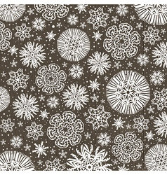 Christmas snowflakes over wooden background vector image