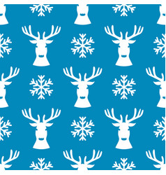 Seamless pattern with deer and snowflake vector