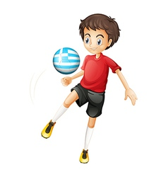 A young football player using the ball from Greece vector image