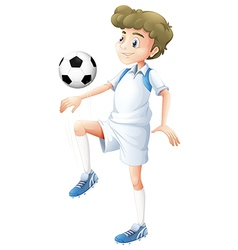 A tall boy playing soccer vector image