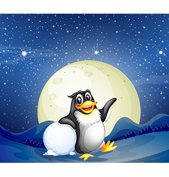 A penguin beside the snowball vector