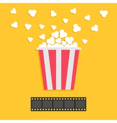 Popcorn popping Film strip Red yellow box Cinema vector image vector image