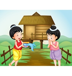 Two thai girls on water festival day vector