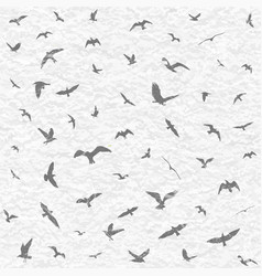 Flying birds silhouettes on white grunge vector