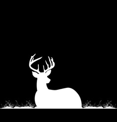 Silhouette of deer with antlers on the grass vector image