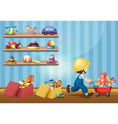 Boy playing with toys in the room vector image