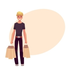 Smiling young man standing with shopping bags vector