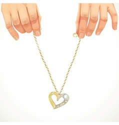 Male hands holding a gold chain with pendant-heart vector image vector image