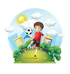 A soccer player practicing near the high buildings vector image