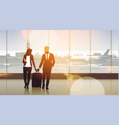 silhouette couple in airport waiting hall vector image