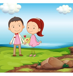 A couple at the riverbank near the rocks vector image vector image