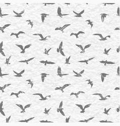 Grunge seamless pattern of flying birds white vector