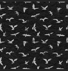 Grunge seamless pattern of flying birds black vector