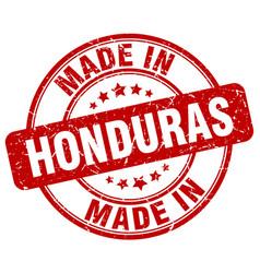 Made in honduras red grunge round stamp vector