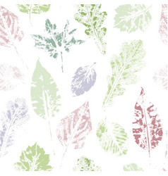 Seamless pattern of hand-printed spring leaves vector