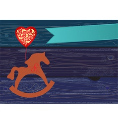 Rocking horse with a heart shaped balloon vector image