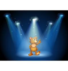 A stage with a huggable bear vector