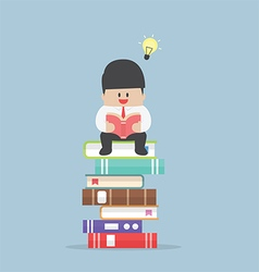 Businessman sitting on the stack of book and read vector