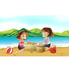 Two friends making a castle at the beach vector image vector image