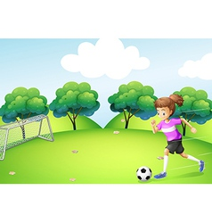 An athletic girl playing soccer vector