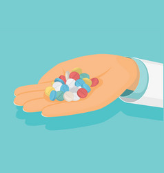doctor holds a handful of pills in hand medical vector image vector image