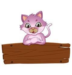 An adorable cat leaning over the empty wooden vector image vector image