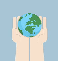 Hand holding the world vector image